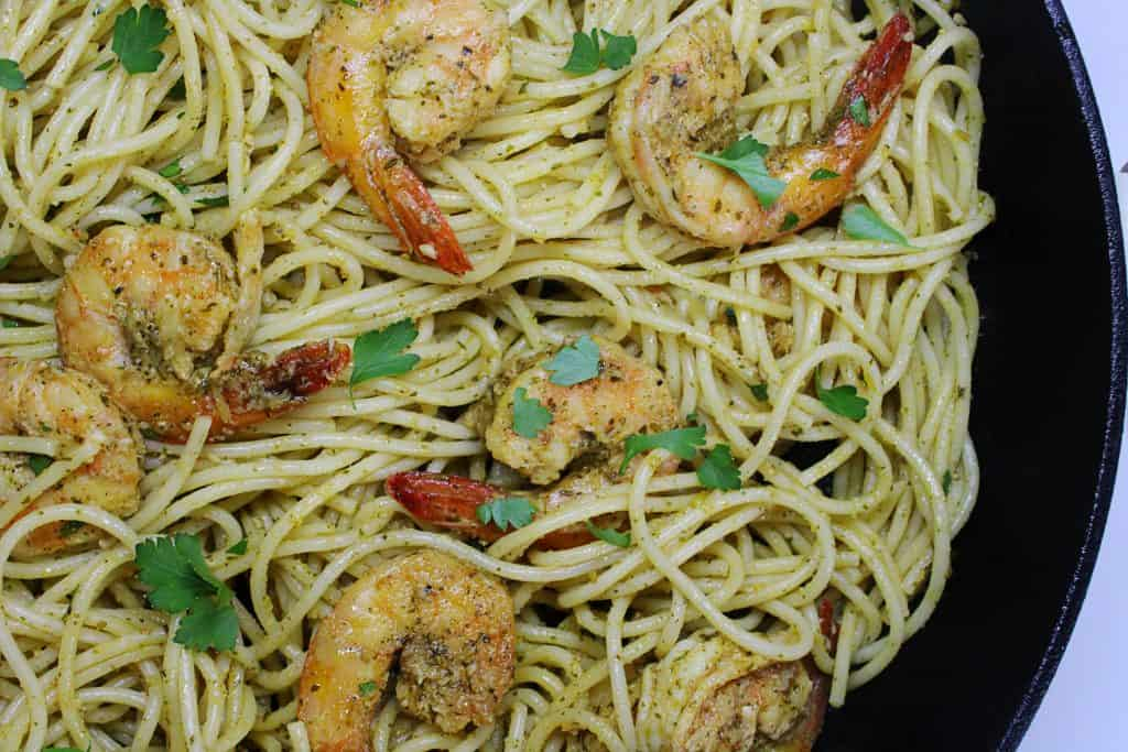 shrimp in skillet pan with garlic and mediterranean herbs pasta