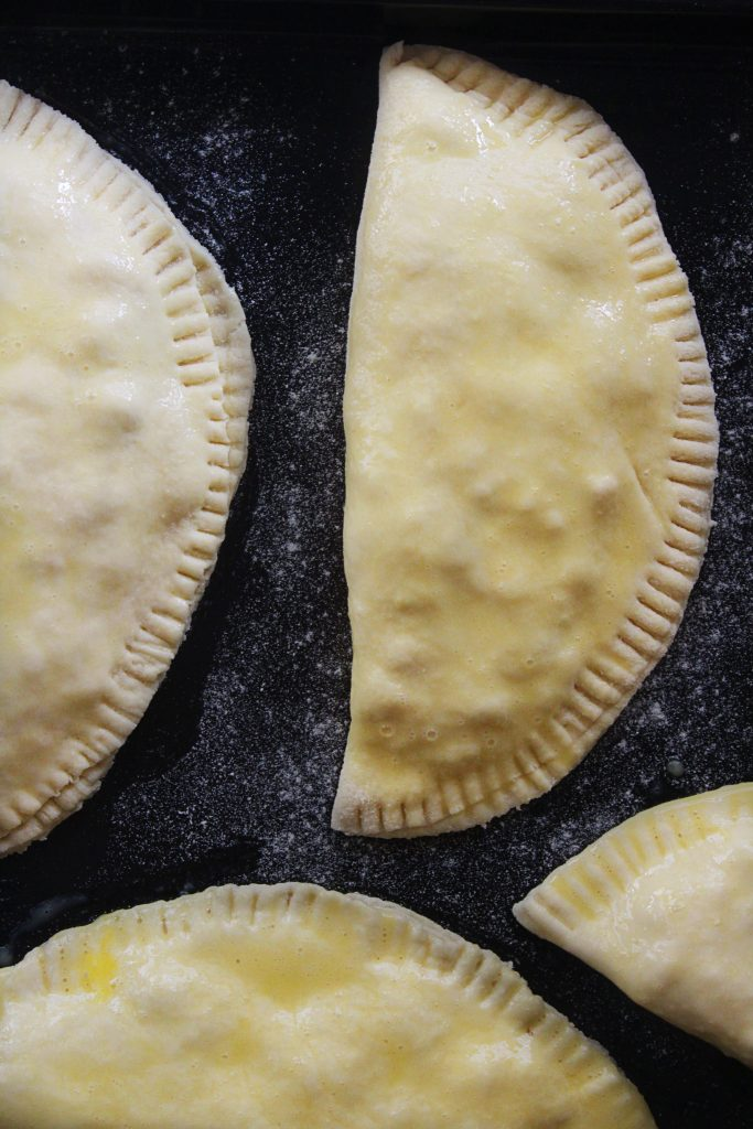 Mini pita bread hand pies with feta cheese