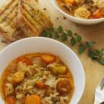 Cabbage and rice stew two plates with bread