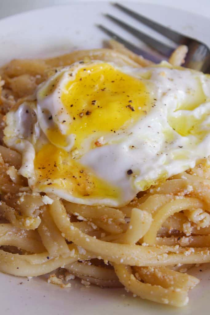 PASTA WITH MIZITHRA CHEESE AND EGG close