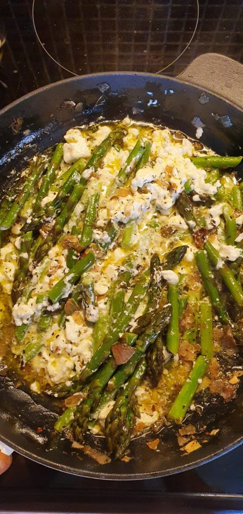 Skillet with apsaragus and feta cheese ingredients