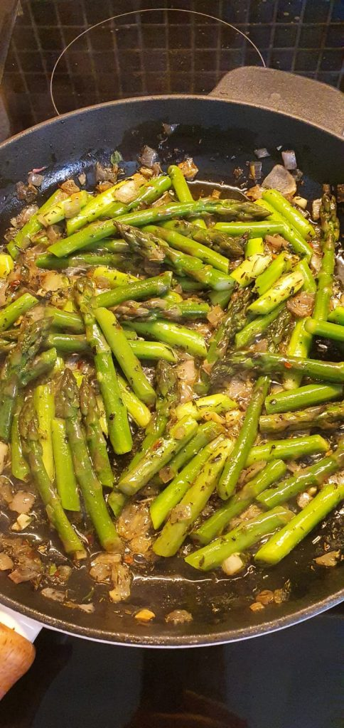 Skillet with asparagus and herbs