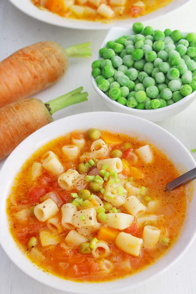 Minestrone soup with peas and carrots