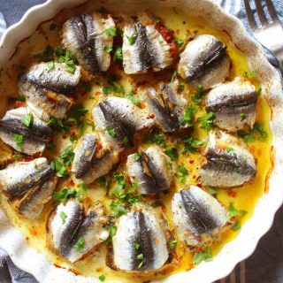 Baked Stuffed Sardines in a round baking dish