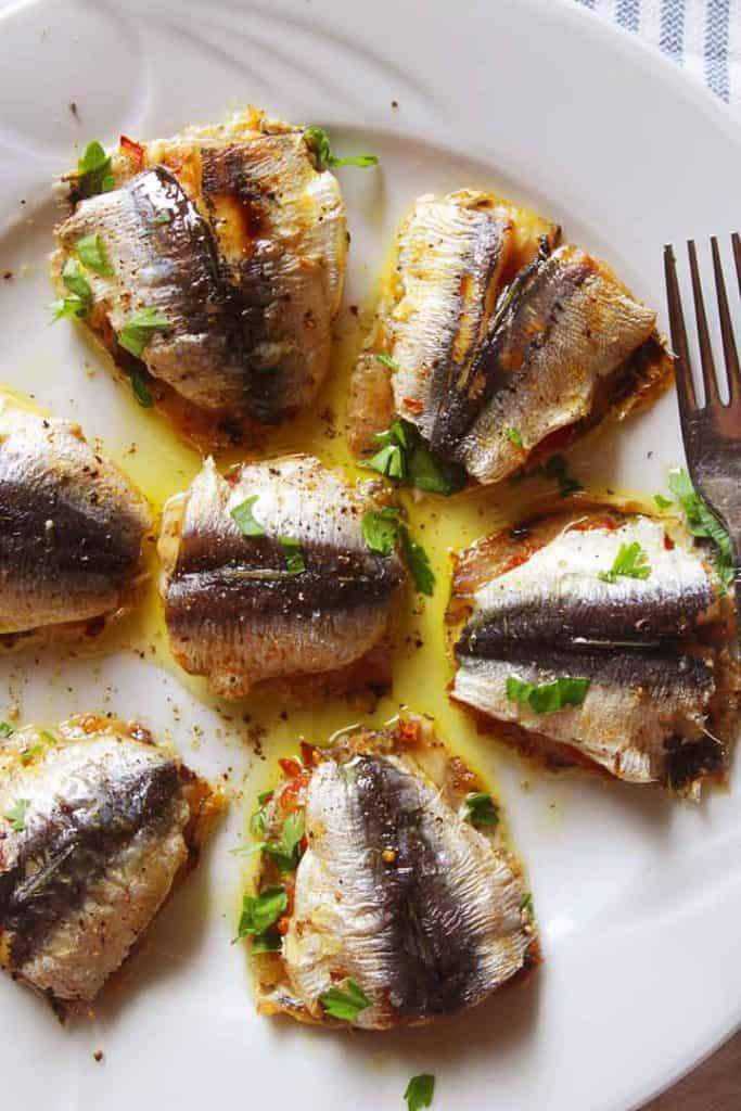 Baked stuffed sardines on a plate